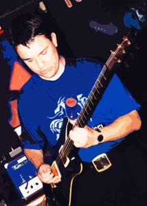 Simon Ashworth playing guitar